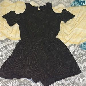 Adorable black and sparkly gold stripped romper!